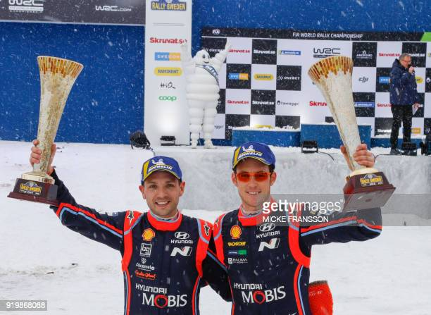 Codriver Nicolas Gilsoul and driver Thierry Neuville of Belgium celebrate after winning the Rally Sweden 2018 as part of the World Rally Championship...