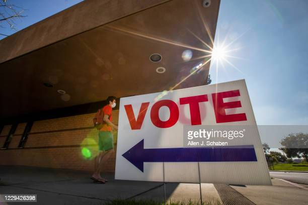 Cody Abril, of Fullerton, exits after voting early in the General Election at California State University, Fullerton Monday, Nov. 2, 2020 in...
