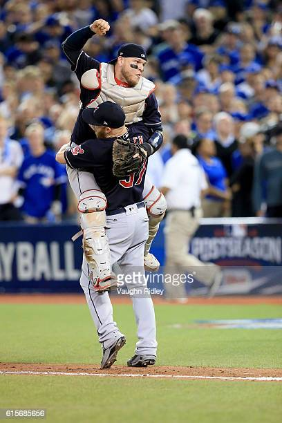 Cody Allen and Roberto Perez of the Cleveland Indians celebrate after defeating the Toronto Blue Jays with a score of 3 to 0 in game five of the...