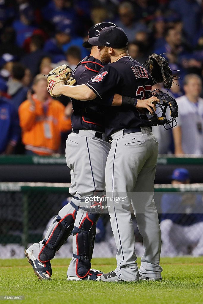 Cody Allen #37 and Roberto Perez #55 of the Cleveland Indians celebrate after beating the Chicago Cubs 1-0 in Game Three of the 2016 World Series at Wrigley Field on October 28, 2016 in Chicago, Illinois.