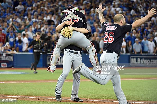 Cody Allen and Roberto Perez of the Cleveland Indians celebrate defeating the Toronto Blue Jays in Game 5 of the ALCS at the Rogers Centre on...