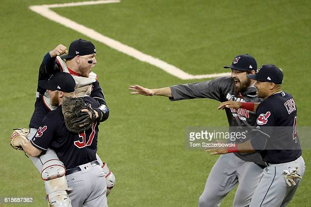 Cody Allen and Roberto Perez of the Cleveland Indians celebrate with their teammates Andrew Miller and Coco Crisp after defeating the Toronto Blue...