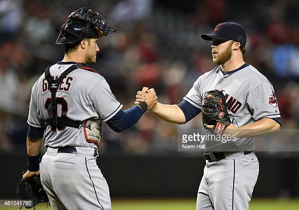 Cody Allen and teammate Yan Gomes of the Cleveland Indians celebrate a 61 victory against the Arizona Diamondbacks at Chase Field on June 25 2014 in...