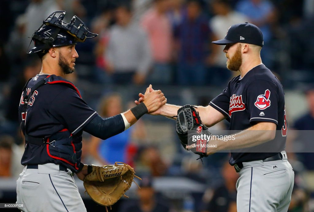 Cody Allen #37 and Yan Gomes #7 of the Cleveland Indians celebrate after defeating the New York Yankees at Yankee Stadium on August 28, 2017 in the Bronx borough of New York City.