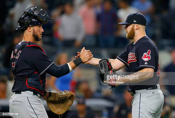Cody Allen and Yan Gomes of the Cleveland Indians celebrate after defeating the New York Yankees at Yankee Stadium on August 28 2017 in the Bronx...