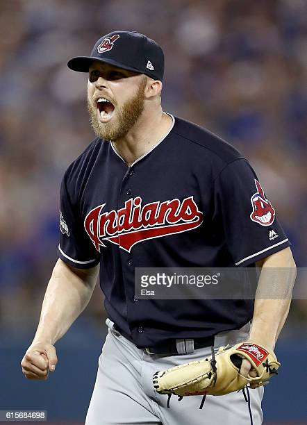 Cody Allen of the Cleveland Indians celebrates after defeating the Toronto Blue Jays with a score of 3 to 0 in game five of the American League...