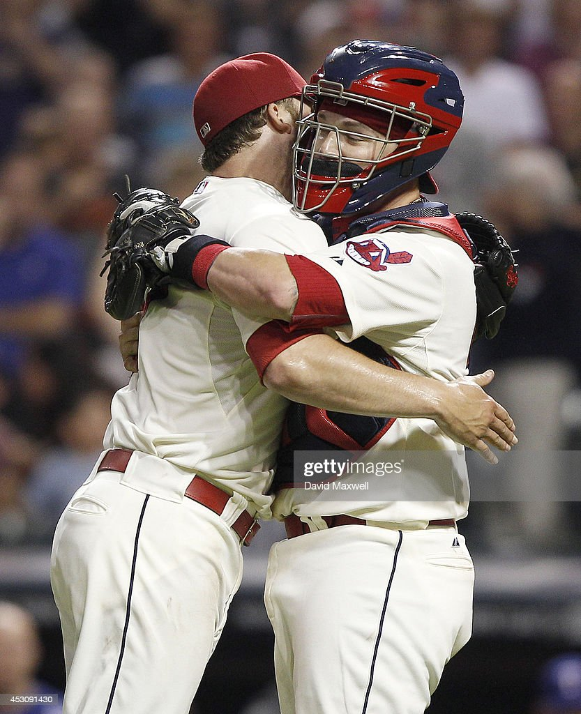 Cody Allen #37 of the Cleveland Indians celebrates with Roberto Perez #55 after defeating the Texas Rangers on August 2, 2014 at Progressive Field in Cleveland, Ohio. The Indians defeated the Rangers 2-0.