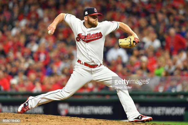 Cody Allen of the Cleveland Indians delivers the pitch during the eighth inning against the New York Yankees during game one of the American League...