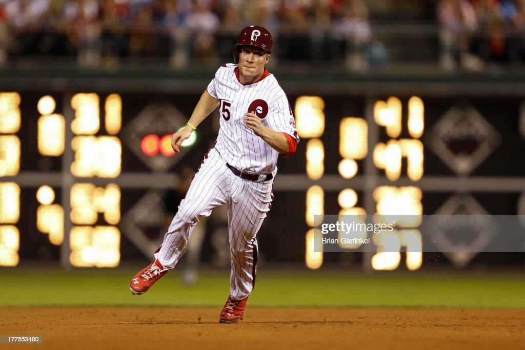Cody Asche #25 of the Philadelphia Phillies advances to third in the bottom of the ninth inning of the game against the Arizona Diamondbacks at Citizens Bank Park on August 23, 2013 in Philadelphia, Pennsylvania. The Phillies won 4-3.
