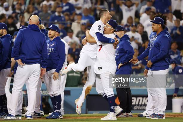 Cody Bellinger and Julio Urias of the Los Angeles Dodgers celebrate their 3 to 1 win over the St. Louis Cardinals during the National League Wild...