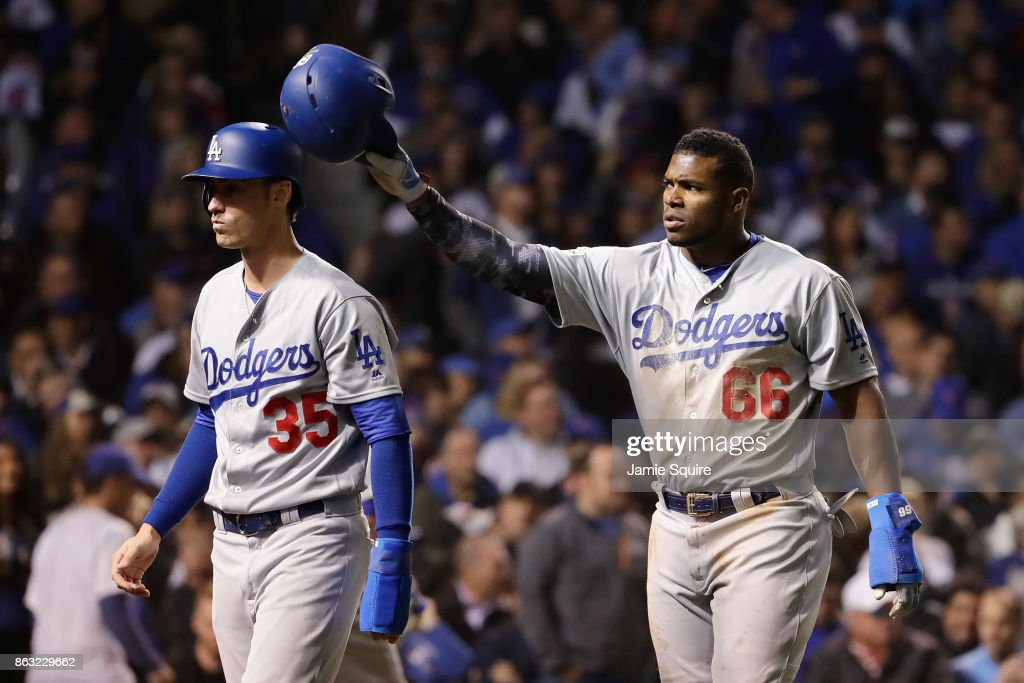 Cody Bellinger #35 and Yasiel Puig #66 of the Los Angeles Dodgers celebrate after scoring runs in the fourth inning against the Chicago Cubs during game five of the National League Championship Series at Wrigley Field on October 19, 2017 in Chicago, Illinois.