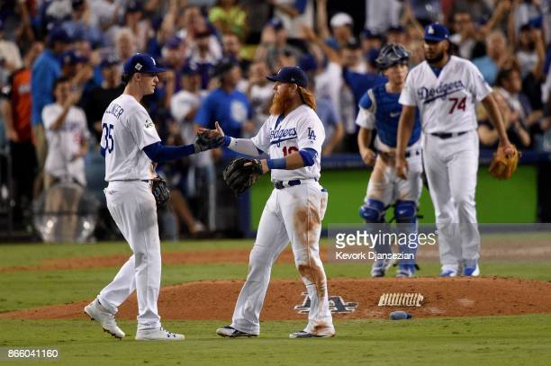 Cody Bellinger celebrates with Justin Turner of the Los Angeles Dodgers after defeating the Houston Astros 31 in game one of the 2017 World Series at...