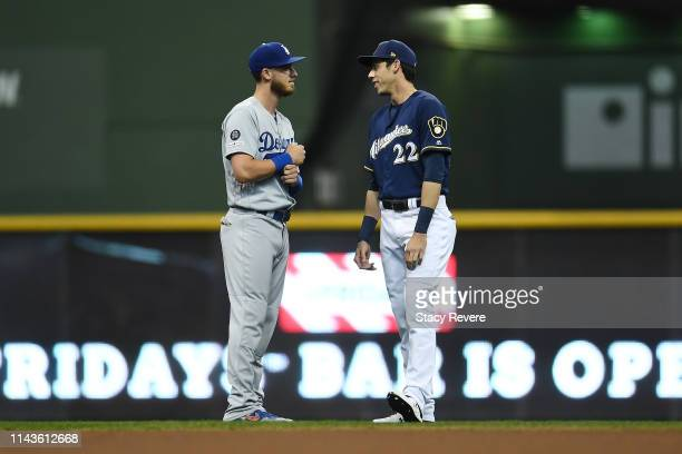 Cody Bellinger of the Los Angeles Dodgers and Christian Yelich of the Milwaukee Brewers talk prior to a game at Miller Park on April 18 2019 in...