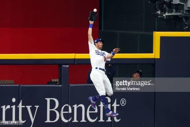 Cody Bellinger of the Los Angeles Dodgers catches a fly ball on a hit by Austin Meadows of the Tampa Bay Rays during the ninth inning in Game One of...