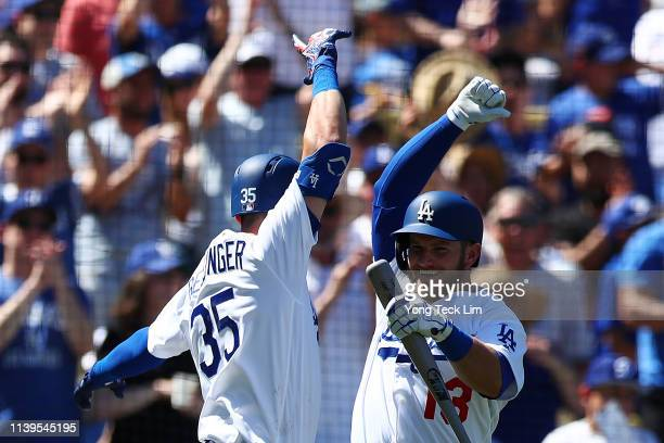 Cody Bellinger of the Los Angeles Dodgers celebrates a home run off pitcher Luke Weaver of the Arizona Diamondbacks with Max Muncy during the third...