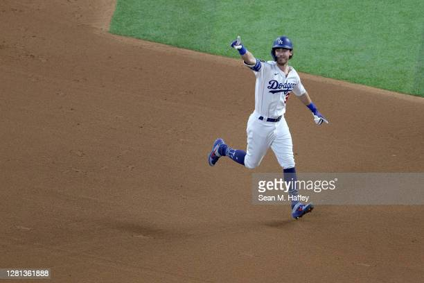 Cody Bellinger of the Los Angeles Dodgers celebrates after hitting a two run home run against the Tampa Bay Rays during the fourth inning in Game One...