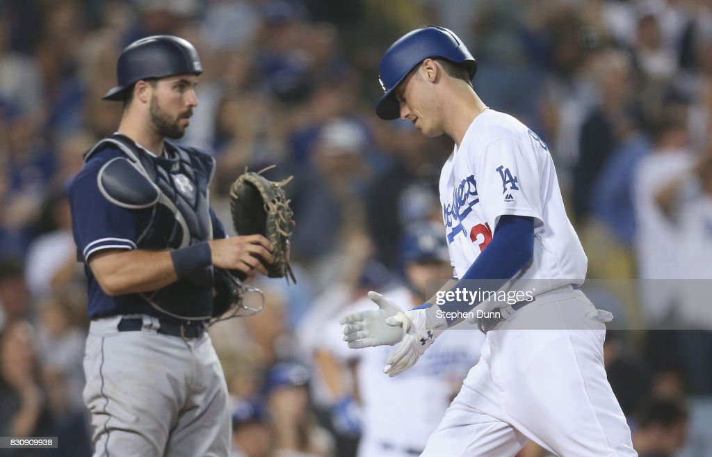 Cody Bellinger #35 of the Los Angeles Dodgers celebrates as he crosses home plate after hitting a solo home run in the seventh inning past catcher Austin Hedges #18 of the San Diego Padres at Dodger Stadium on August 12, 2017 in Los Angeles, California.