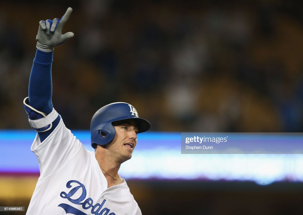Cody Bellinger #35 of the Los Angeles Dodgers celebrates as he runs to first base after hitting a solo home run in the ningh inning against the Philadelphia Phillies at Dodger Stadium on April 29, 2017 in Los Angeles, California. It was Bellingers second home run of the night with the first being his first Major League home run. It was also the second of three home runs in a row to lead off the ninth and bring the Dodgers back to tie the game at 5-5. The Dodgers went on to win 6-5.
