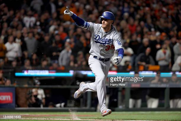 Cody Bellinger of the Los Angeles Dodgers celebrates his RBI single to score Justin Turner against the San Francisco Giants during the ninth inning...