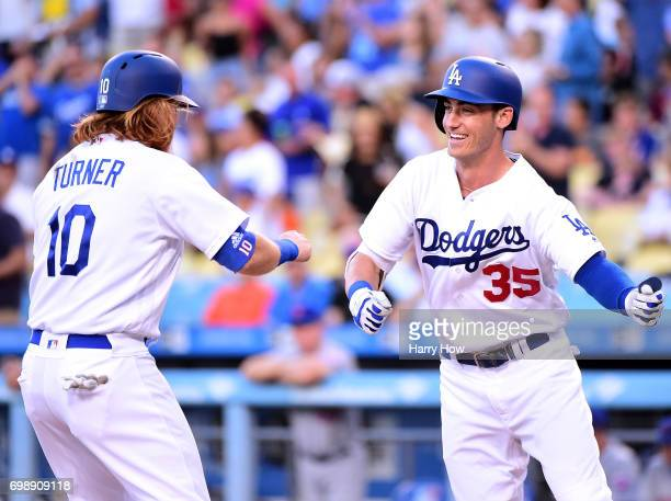 Cody Bellinger of the Los Angeles Dodgers celebrates his two run homerun with Justin Turner to take a 40 lead over the New York Mets during the first...