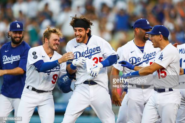 Cody Bellinger of the Los Angeles Dodgers celebrates his walk-off home run against the Chicago Cubs with teammates in the ninth inning at Dodger...