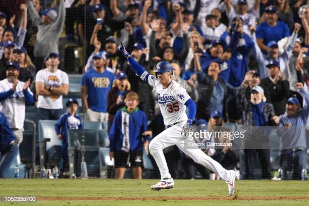 Cody Bellinger of the Los Angeles Dodgers celebrates hitting a walkoff single in the thirteenth inning against the Milwaukee Brewers to win Game Four...