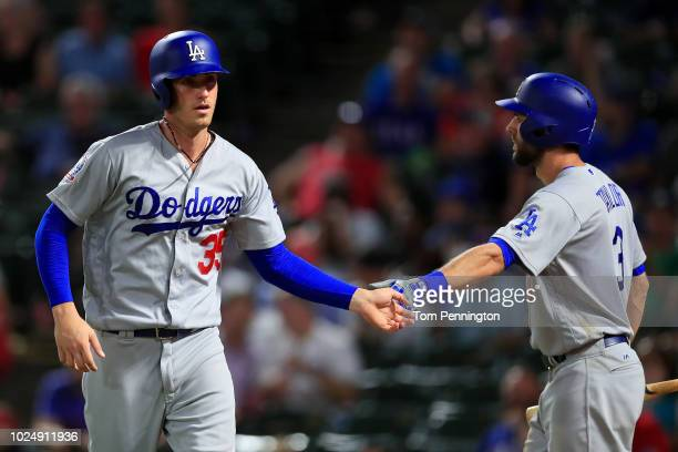 Cody Bellinger of the Los Angeles Dodgers celebrates with Chris Taylor of the Los Angeles Dodgers after scoring against the Texas Rangers at Globe...