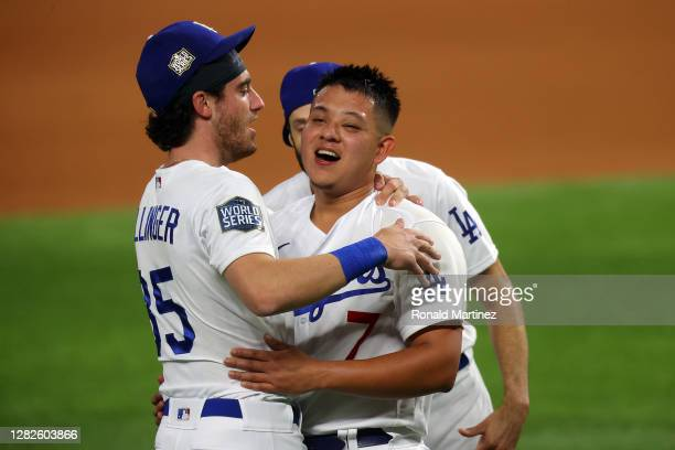 Cody Bellinger of the Los Angeles Dodgers celebrates with Julio Urias and Joe Kelly after defeating the Tampa Bay Rays 3-1 in Game Six to win the...