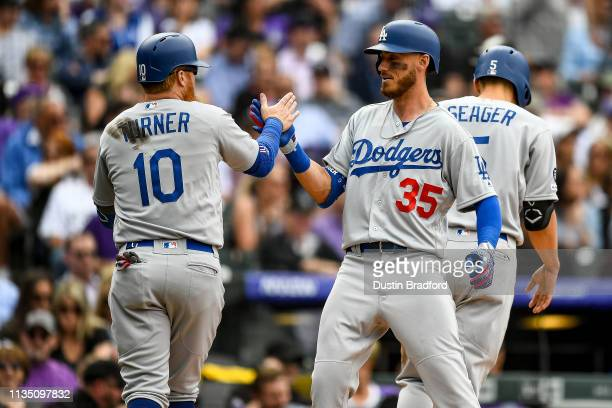 Cody Bellinger of the Los Angeles Dodgers celebrates with Justin Turner after hitting a fifth inning threerun homer against the Colorado Rockies...