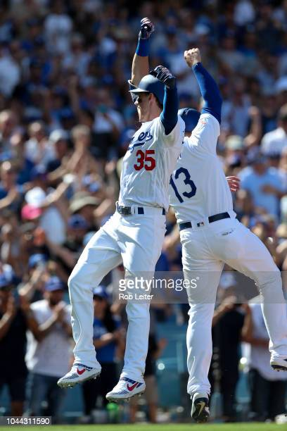 Cody Bellinger of the Los Angeles Dodgers celebrates with Max Muncy after hitting a tworun home run during the fourth inning against the Colorado...