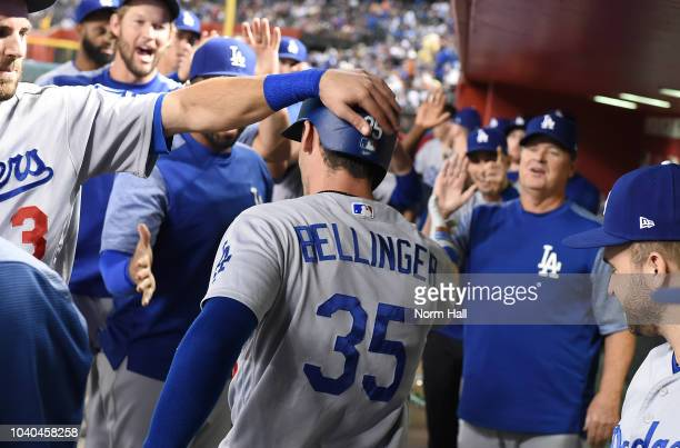 Cody Bellinger of the Los Angeles Dodgers celebrates with teammates in the dugout after hitting a solo home run during the second inning against the...