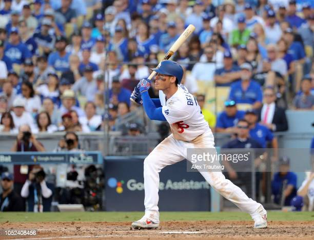 Cody Bellinger of the Los Angeles Dodgers doubles in the seventh inning of Game 5 of the NLCS against the Milwaukee Brewers at Dodger Stadium on...