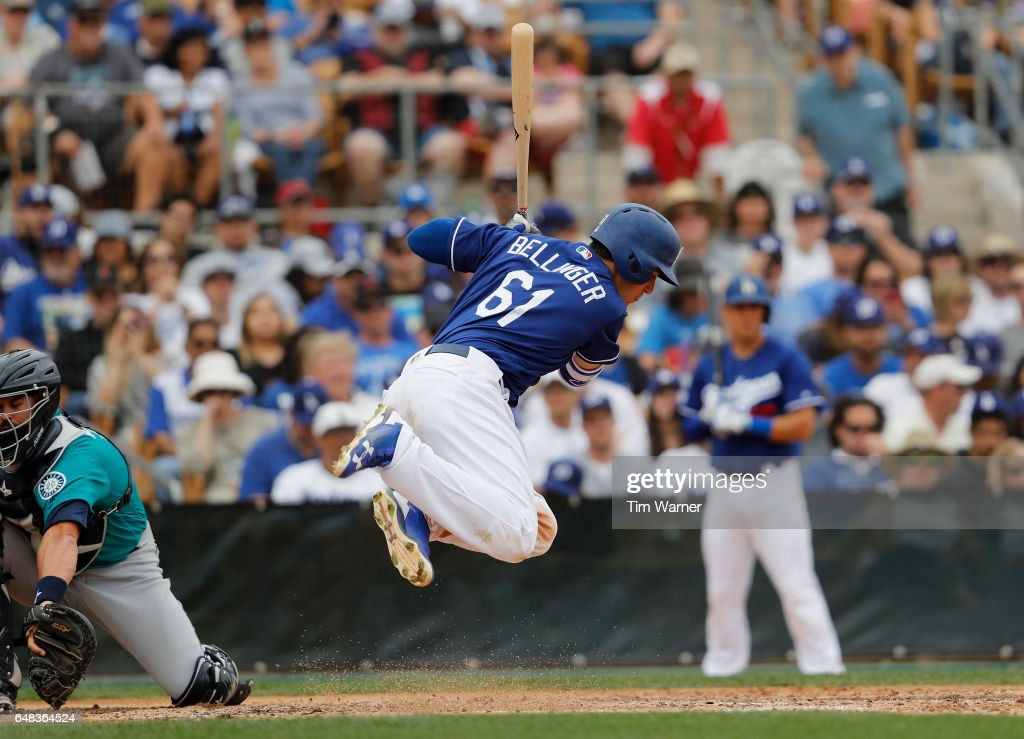 Cody Bellinger #61 of the Los Angeles Dodgers gets out of the way of an inside pitch in the sixth inning against the Seattle Mariners during the spring training game at Camelback Ranch on March 5, 2017 in Glendale, Arizona.