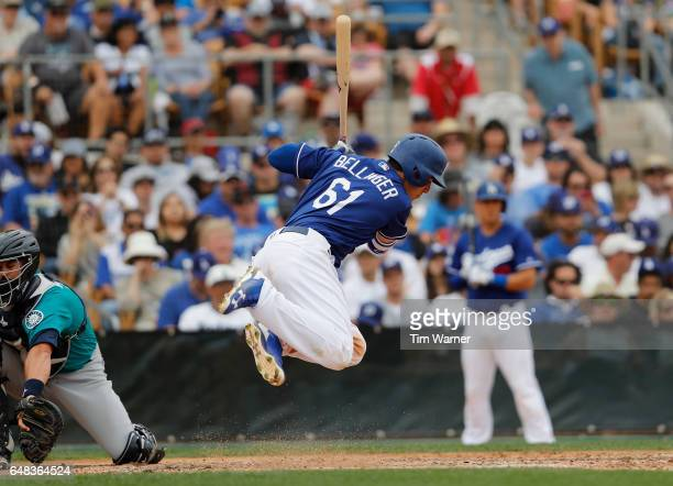 Cody Bellinger of the Los Angeles Dodgers gets out of the way of an inside pitch in the sixth inning against the Seattle Mariners during the spring...