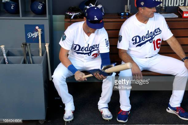 Cody Bellinger of the Los Angeles Dodgers gets ready in the dugout prior to Game 3 of the 2018 World Series against the Boston Red Sox at Dodger...