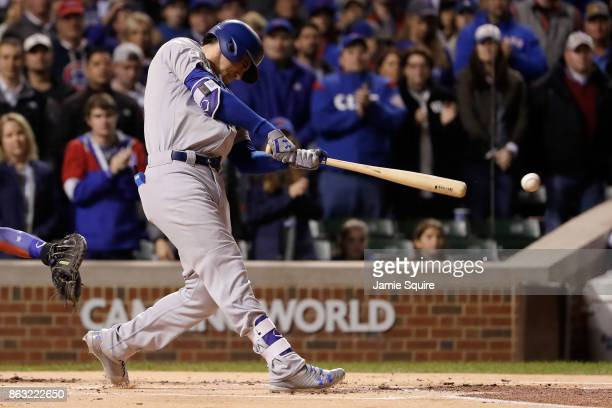 Cody Bellinger of the Los Angeles Dodgers hits a double in the first inning against the Chicago Cubs during game five of the National League...