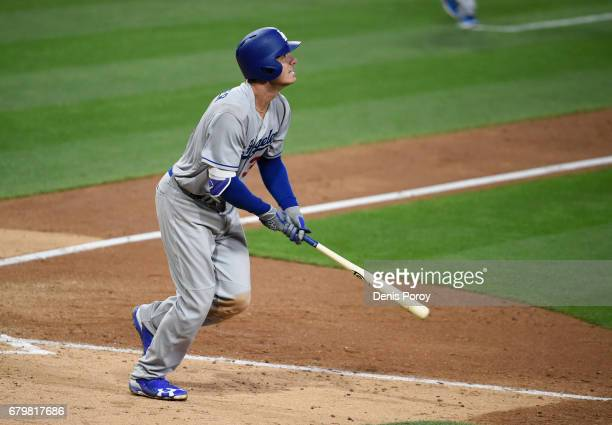 Cody Bellinger of the Los Angeles Dodgers hits a grand slam during the ninth inning of a baseball game against the San Diego Padres at PETCO Park on...