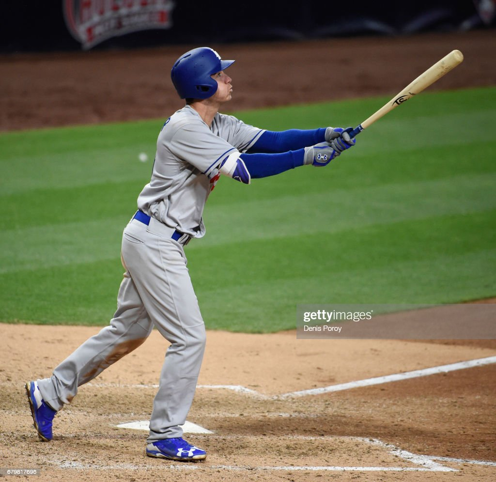 Cody Bellinger #35 of the Los Angeles Dodgers hits a grand slam during the ninth inning of a baseball game against the San Diego Padres at PETCO Park on May 6, 2017 in San Diego, California.