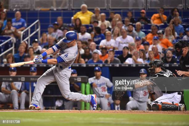 Cody Bellinger of the Los Angeles Dodgers hits a home run in the third inning against the Miami Marlins at Marlins Park on July 15 2017 in Miami...