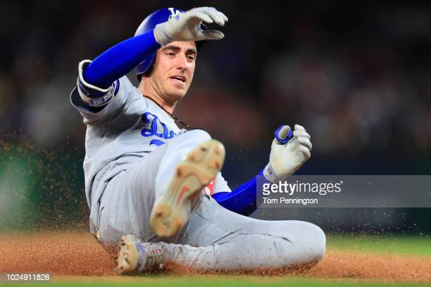 Cody Bellinger of the Los Angeles Dodgers hits a leadoff triple against the Texas Rangers in the top of the seventh inning at Globe Life Park in...