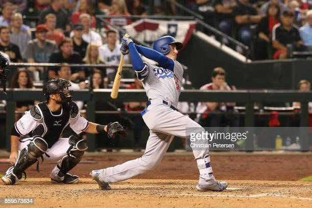 Cody Bellinger of the Los Angeles Dodgers hits a one run home run during the fifth inning of the National League Divisional Series game three against...
