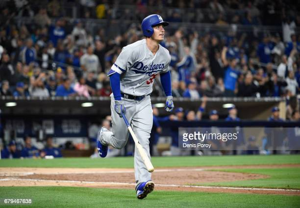 Cody Bellinger of the Los Angeles Dodgers hits a solo home run during the fourth inning of a baseball game against the San Diego Padres at PETCO Park...