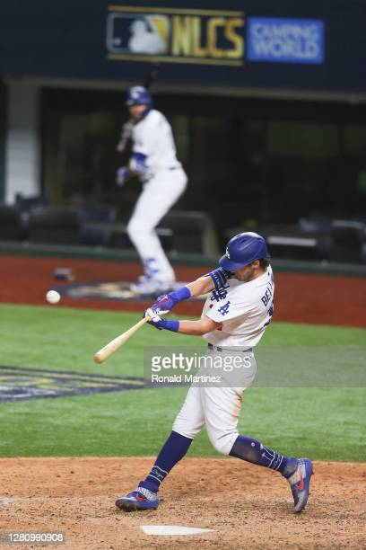 Cody Bellinger of the Los Angeles Dodgers hits a solo home run against the Atlanta Braves during the seventh inning in Game Seven of the National...