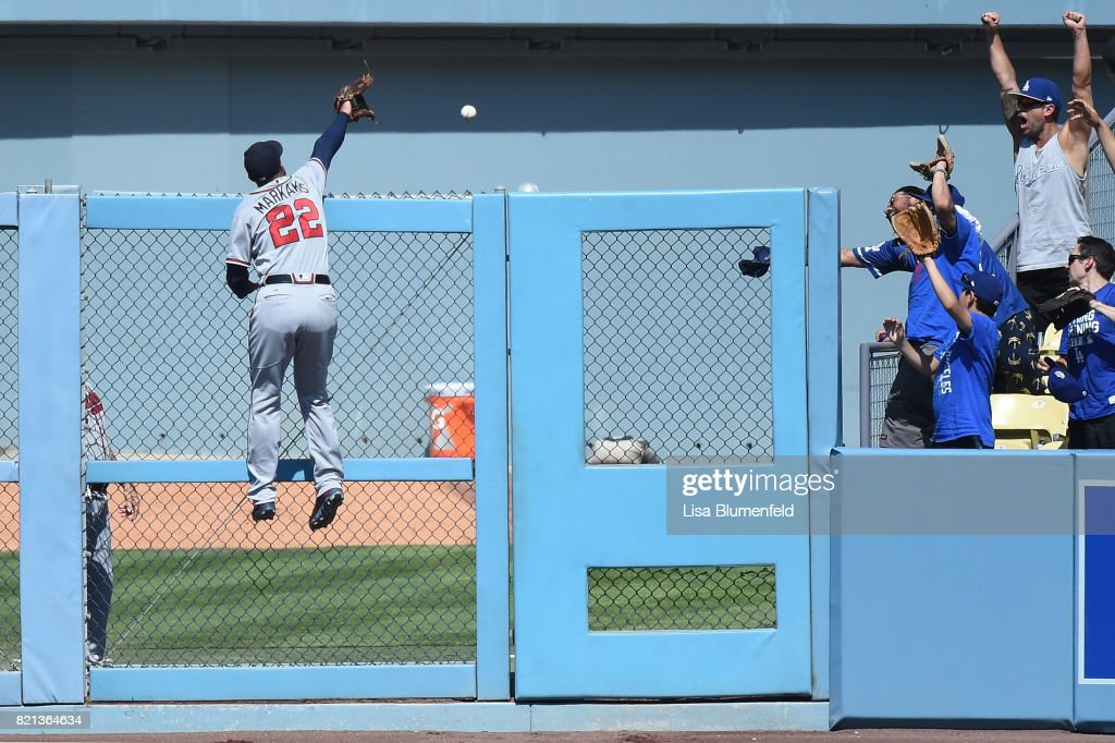 Cody Bellinger #35 of the Los Angeles Dodgers hits a solo homerun in the eighth inning over Nick Markakis #22 of the Atlanta Braves at Dodger Stadium on July 23, 2017 in Los Angeles, California.