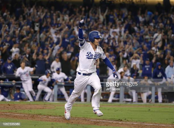 Cody Bellinger of the Los Angeles Dodgers hits a walkoff single for the win in the 13th inning of Game Four of the National League Championship...