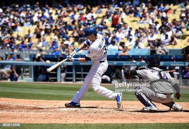 Cody Bellinger of the Los Angeles Dodgers hits his 23rd home run of the season against Colorado Rockies to score teammate Justin Turner during the...