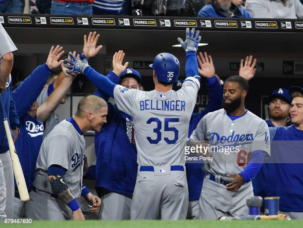 Cody Bellinger of the Los Angeles Dodgers is congratulated after hitting a solo home run during the fourth inning of a baseball game against the San...
