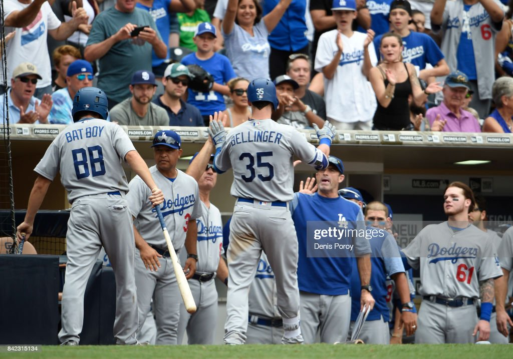 Cody Bellinger #35 of the Los Angeles Dodgers is congratulated after hitting a solo home run during the ninth inning of a baseball game against the San Diego Padres at PETCO Park on September 3, 2017 in San Diego, California.
