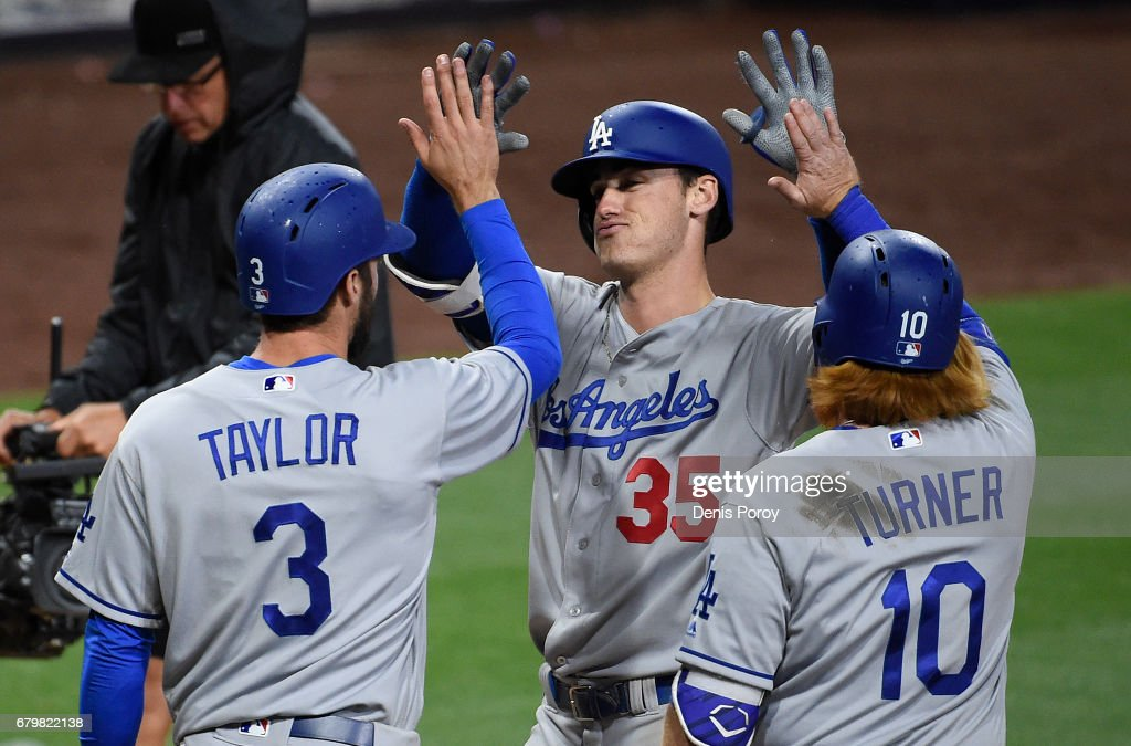 Cody Bellinger #35 of the Los Angeles Dodgers, is congratulated by Chris Taylor #3 and Justin Turner #10 after hitting a grand slam during the ninth inning of a baseball game against the San Diego Padres at PETCO Park on May 6, 2017 in San Diego, California.