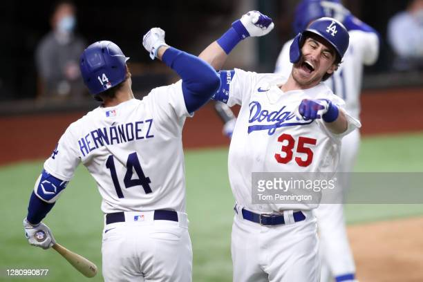 Cody Bellinger of the Los Angeles Dodgers is congratulated by Enrique Hernandez after hitting a solo home run against the Atlanta Braves during the...